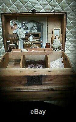 Antique 3 inch German bisque doll and antique wood trunk with accessories