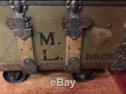 Old Boston Steamer Trunk Converted Into a Coffee Table